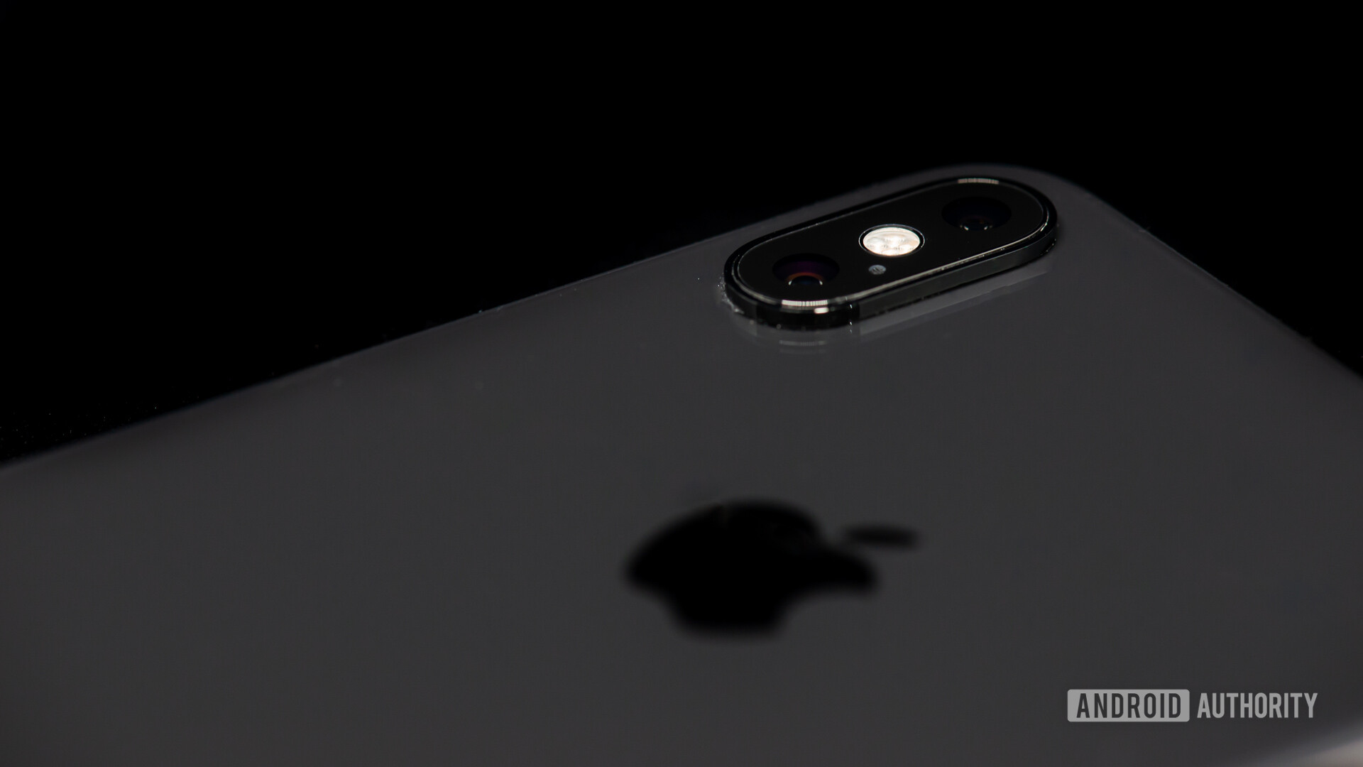iPhone XS Max closeup on camera module and Apple logo